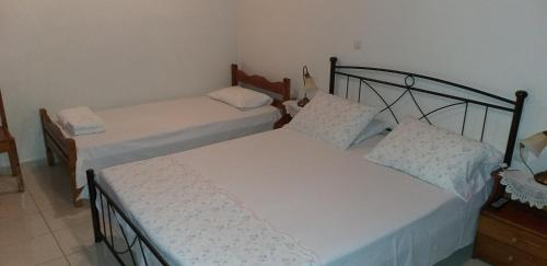 A bed or beds in a room at Toulatos Pantelis