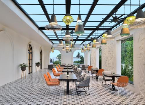 A restaurant or other place to eat at Port Muziris, a Tribute Portfolio Hotel, Kochi