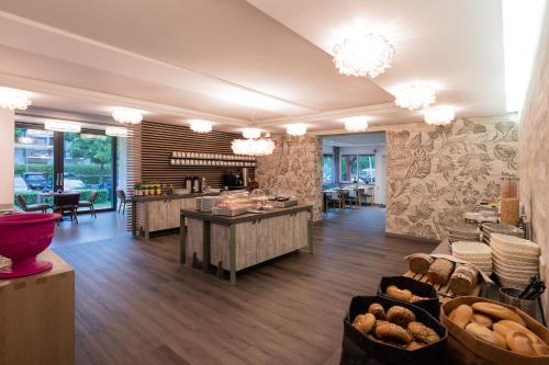 Ein Restaurant oder anderes Speiselokal in der Unterkunft Hotel Birkenhof