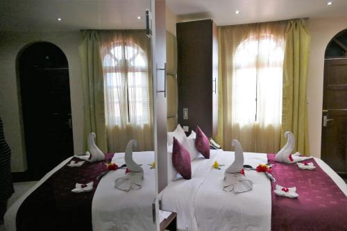 A bed or beds in a room at Best Western Plus Zanzibar