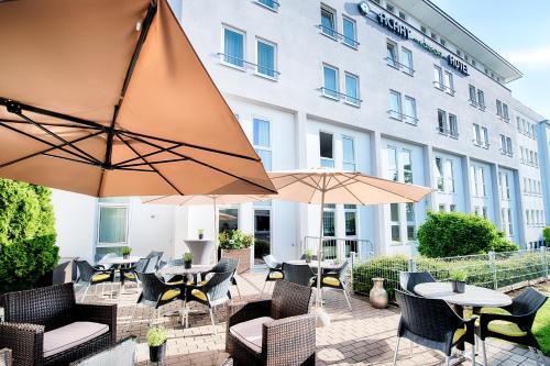 Ein Restaurant oder anderes Speiselokal in der Unterkunft ACHAT Hotel Hockenheim