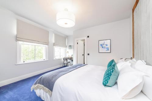 A bed or beds in a room at The Brownswood