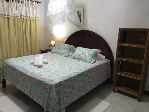 Cama ou camas em um quarto em Catavento Praia Hotel