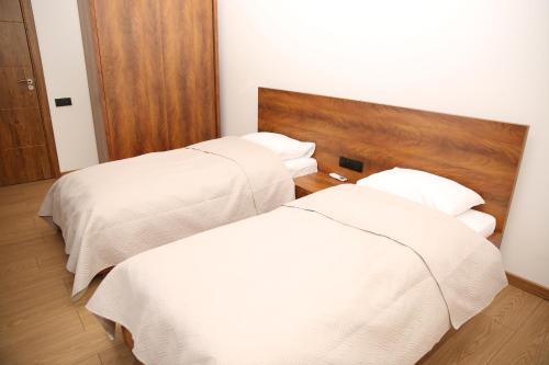 Кровать или кровати в номере Citron Cottages