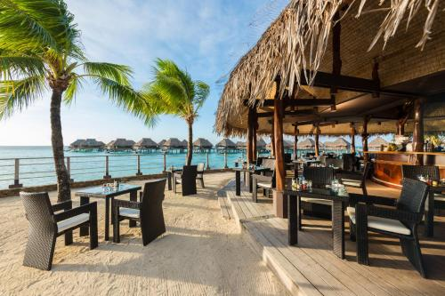 A restaurant or other place to eat at Hilton Moorea Lagoon Resort & Spa