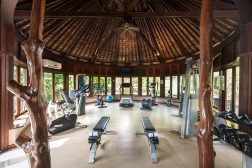 The fitness center and/or fitness facilities at Hilton Moorea Lagoon Resort & Spa