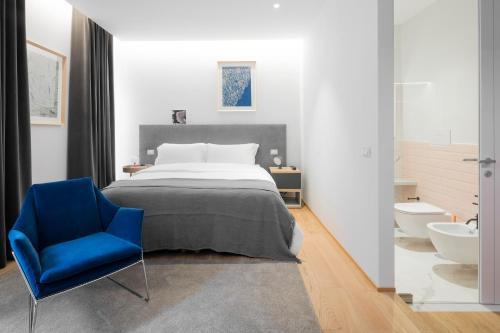 Letto o letti in una camera di The Radical Hotel Roma