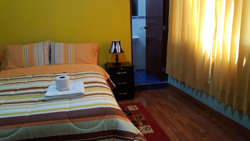 A bed or beds in a room at Hostal Los Pinos