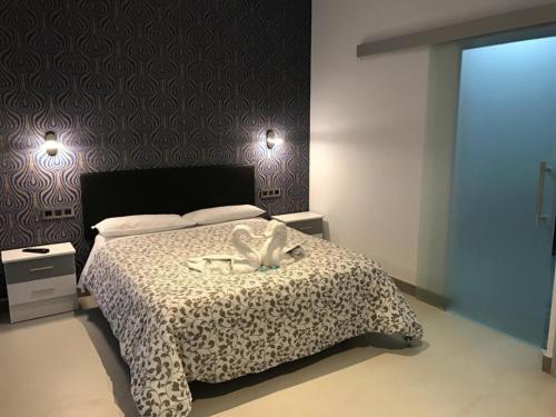 A bed or beds in a room at Pensión Las Setas