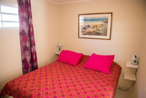 Cama ou camas em um quarto em Jan Thiel Garden Apartement