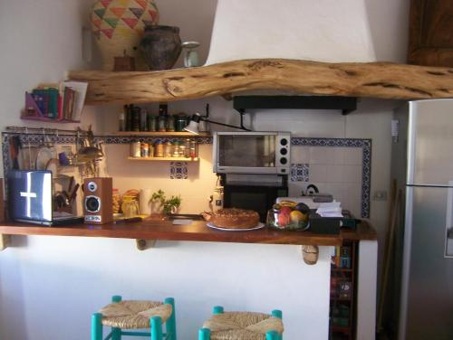 A kitchen or kitchenette at Hosteria Villa Cardon