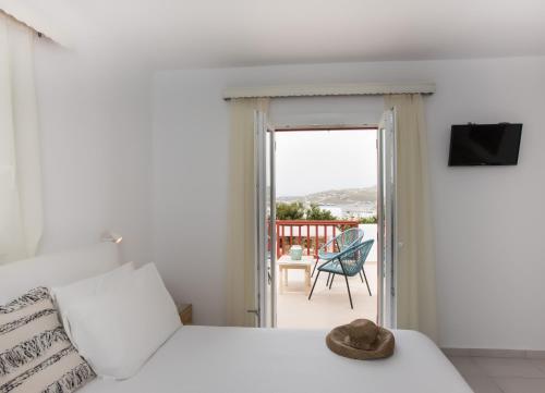 Ένα ή περισσότερα κρεβάτια σε δωμάτιο στο Hotel Charissi