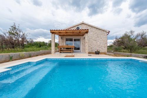 The swimming pool at or close to Holiday Home Katina