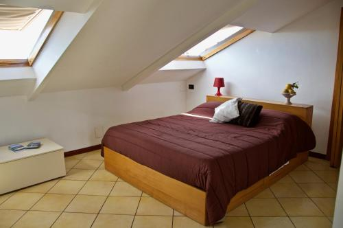 A bed or beds in a room at Blumind