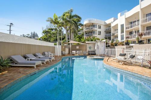 The swimming pool at or near Kirra Palms Holiday Apartments