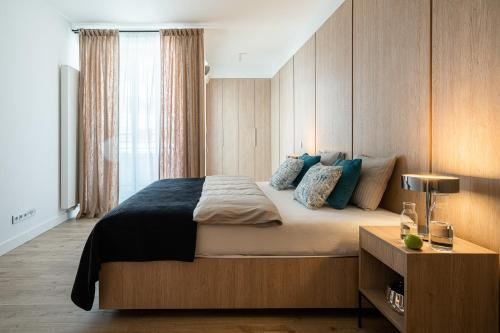 A bed or beds in a room at Apartament 24 - OVO