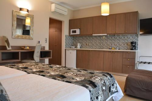 A kitchen or kitchenette at Royalty Suites Sea Side