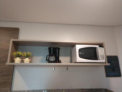 A cozinha ou cozinha compacta de MARULHOS RESORT - STÚDIOS TEMPORADA