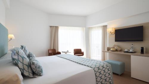 A bed or beds in a room at Pure Salt Garonda - Adults Only