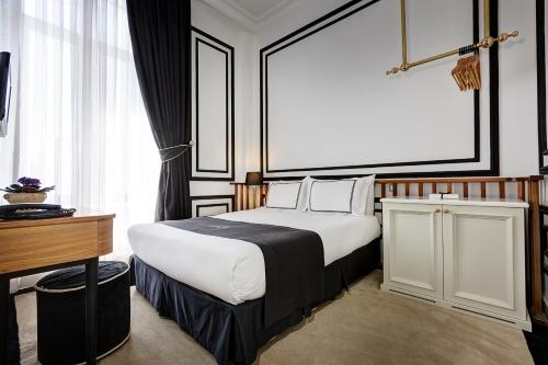 A bed or beds in a room at Galata Antique Hotel - Special Category