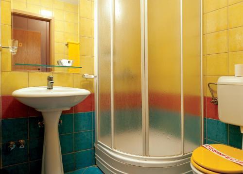 Kúpeľňa v ubytovaní Leonardo Hotel