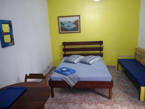 Cama ou camas em um quarto em Pousada Aquaria