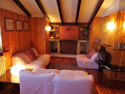 A bed or beds in a room at Appartamento La Primula