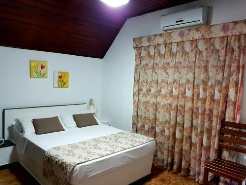 Cama ou camas em um quarto em Hotel Akropolis