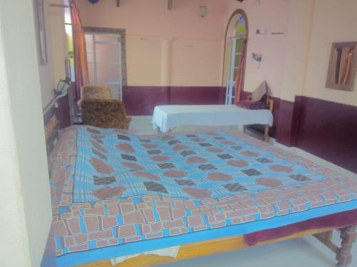 A bed or beds in a room at Kasera Paradise