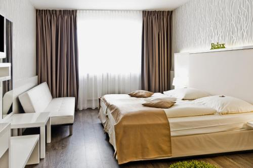 A bed or beds in a room at Quality Hotel Augsburg
