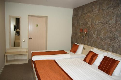 A bed or beds in a room at Hotel Hit