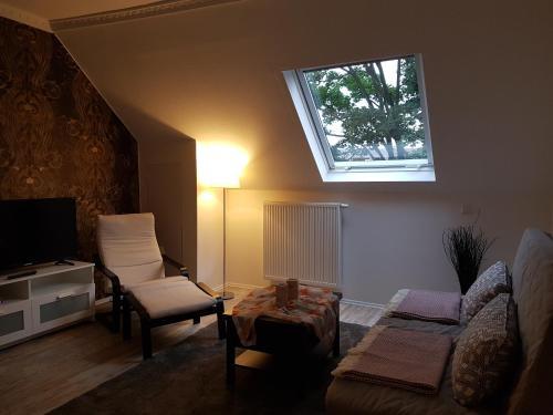 A seating area at Appartment Rheinaue