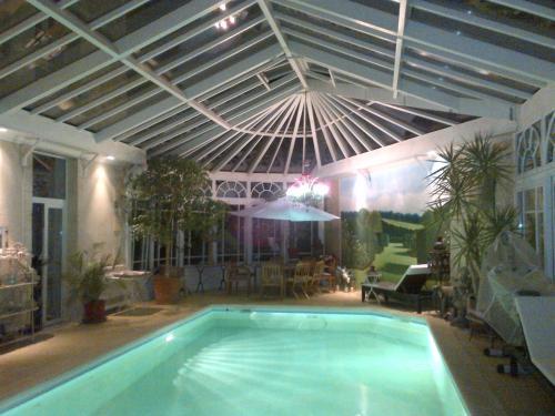 The swimming pool at or near Maison du Théâtre Saint Bonnet