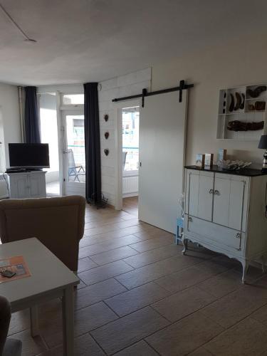 Cuisine ou kitchenette dans l'établissement Sterflat Appartement