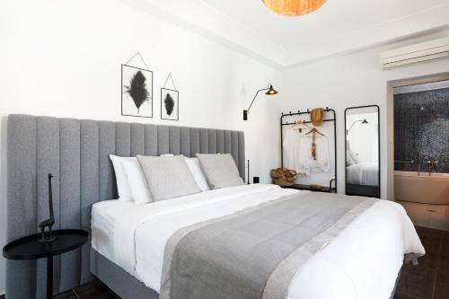A bed or beds in a room at Petit Palace Suites