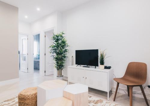 A television and/or entertainment center at Altair apartment by People Rentals
