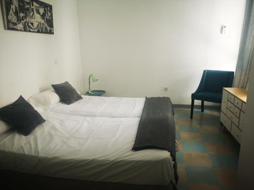 A bed or beds in a room at Feel Hostels Soho Malaga
