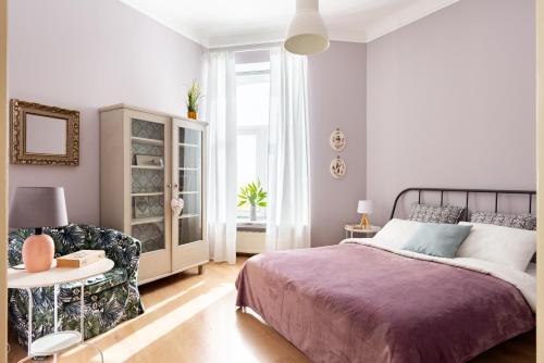 Кровать или кровати в номере GorodRek. Naberezhnaya Kutuzova