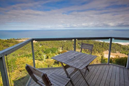 A balcony or terrace at Chris's Beacon Point Restaurant & Villas