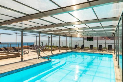 The swimming pool at or near Hotel Boa - Vista