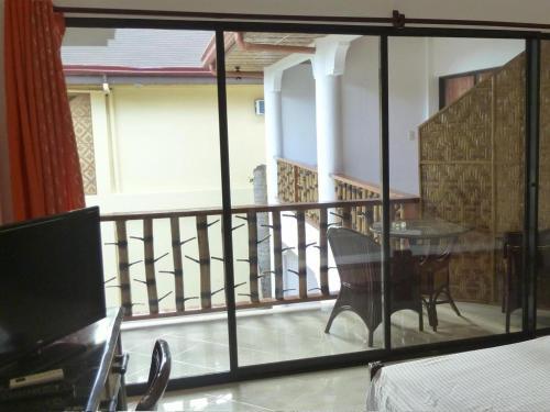A balcony or terrace at Alona Vida Beach Resort