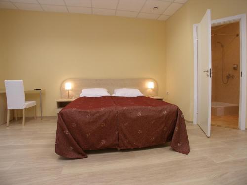 Кровать или кровати в номере Отель Большой 45