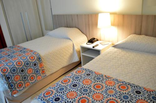 A bed or beds in a room at Catussaba Suítes Resort