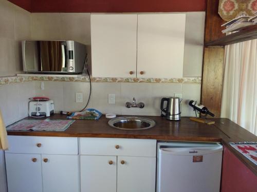 Una cocina o kitchenette en El Aleman