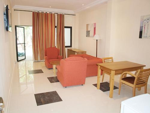 A seating area at Senegambia Beach Hotel