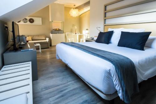 Letto o letti in una camera di Hotel & Spa Princesa Munia