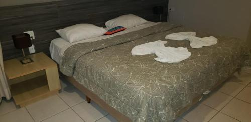 A bed or beds in a room at Beach Class International - Flat