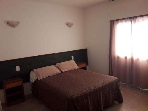 Una cama o camas en una habitación de Hotel Provincial