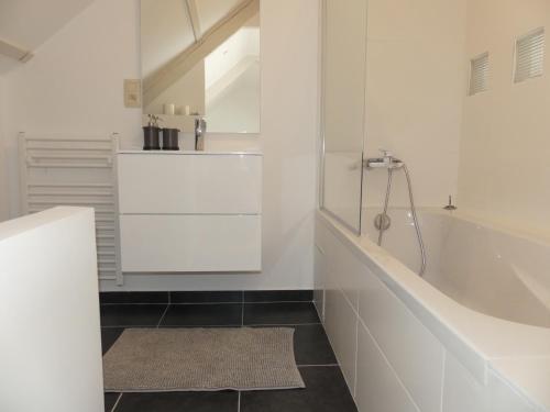 A bathroom at Ilot Sacre Apartments