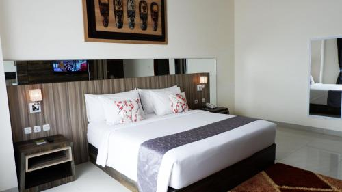 A bed or beds in a room at Vega Hotel